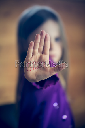 little girl showing palm with the