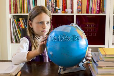 girl looking to globe