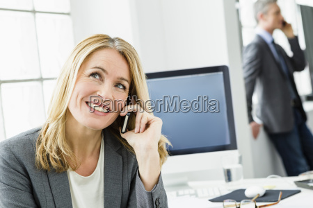 germany businessman and woman talking on