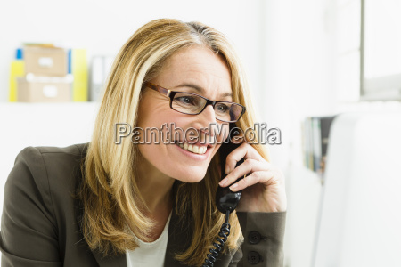 germany bussinesswoman talking on telephone and