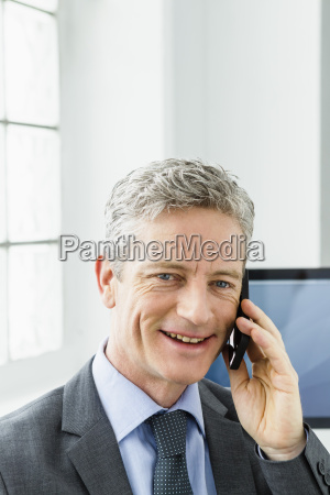 germany businessman talking on mobile phone