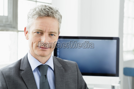 germany portrait of businessman smiling