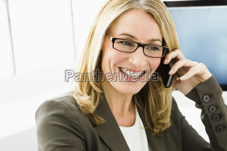 germany businesswoman talking on mobile phone