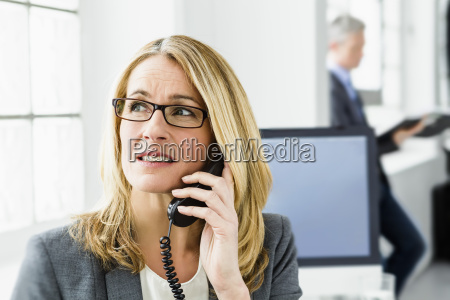 germany businesswoman talking on telephone while