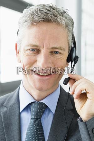 germany businessman talking on head phone