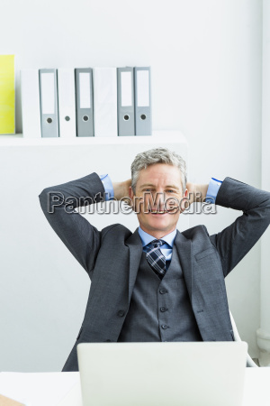 germany portrait of businessman sitting in