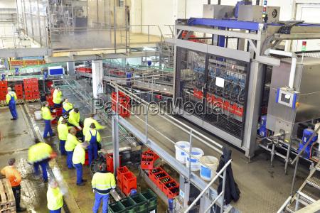 germany men working at bottling plant
