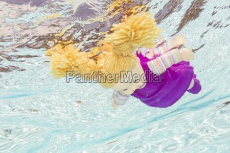 doll under water