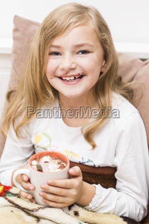 smiling little girl covered with chocolate