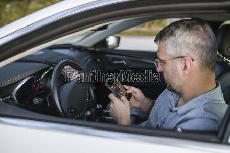 man using smart phone gps sitting