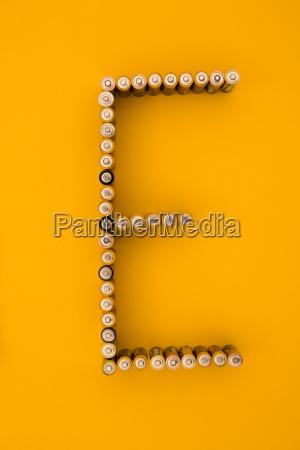 letter e formed of batteries at