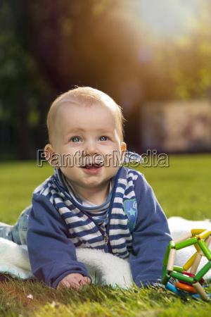portrait of smiling baby boy lying