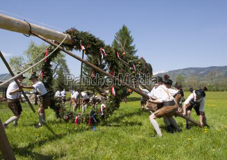 austria people raising maypole