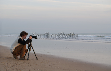spain young man taking photograph of