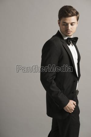 portrait of man wearing tuxedo in