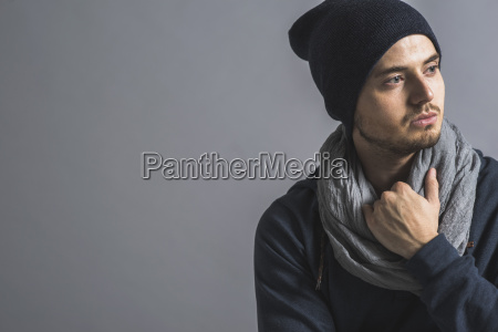 portrait of pensive young man wearing