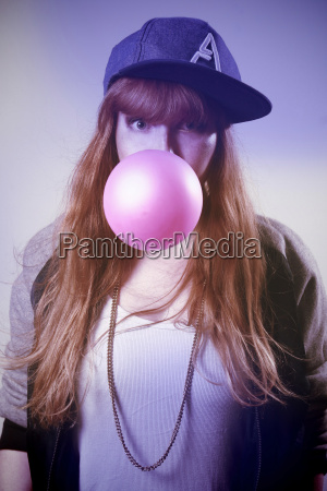 portrait of woman with pink gum