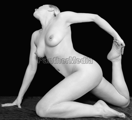 female nude in front of black