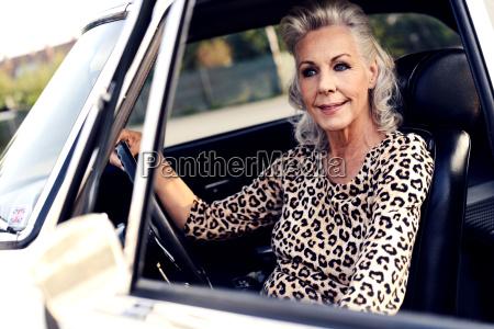 portrait of smiling white haired senior