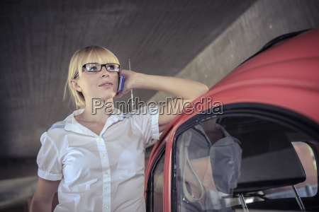 portrait of young woman telephoning with