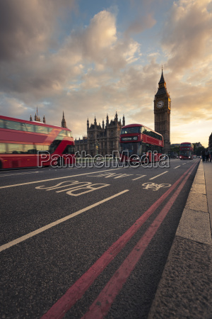 uk london red buses passing westminster