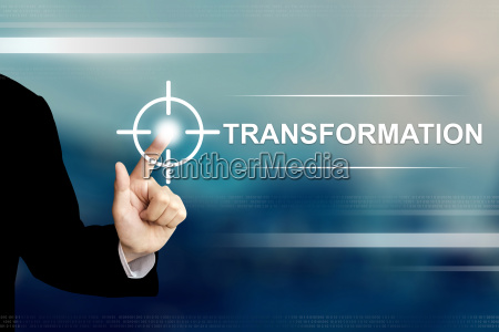 business hand clicking transformation button on