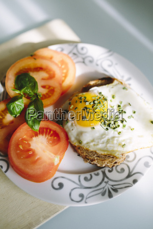 delicious eggs with tomatoes and avocado