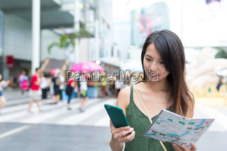 woman checking the location with city