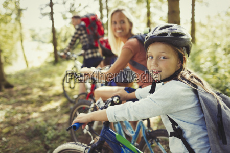 portrait mother and daughter mountain biking