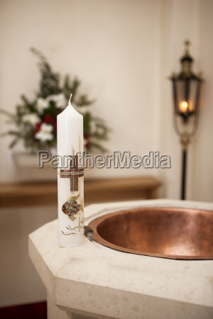 baptismal candle on font