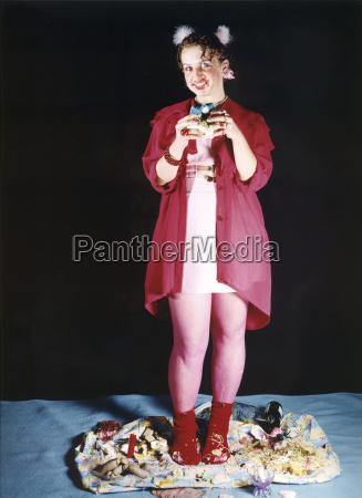teenage girl over eating smiling portrait