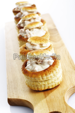 filled patties on wooden board close