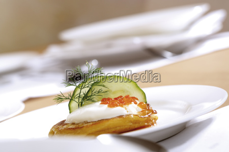 blini with sour cream close up