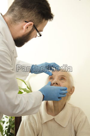the doctor examines the eyes conjunctival