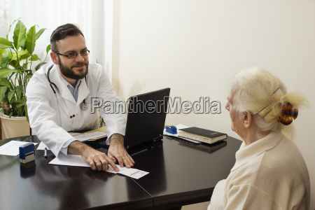 geriatrician doctor with a patient in