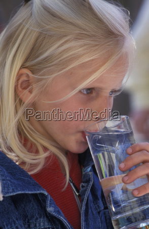 blond girl drinking glass of water