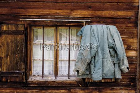 austria tyrol jacket hanging on wooden