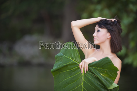 young woman covering herself with elephant