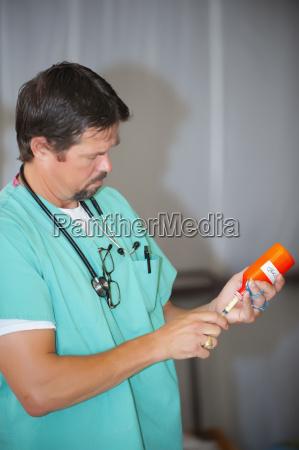 usa texas leakey doctor filling syringe