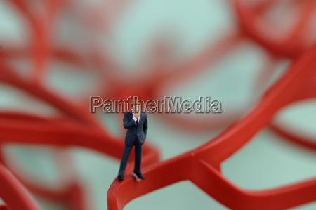figurine of business man