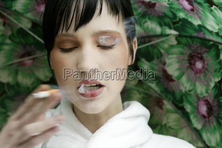 young woman smoking portrait