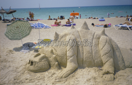 spain mallorca sand dragon with people