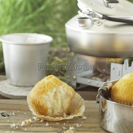 muffin with mug of tea close