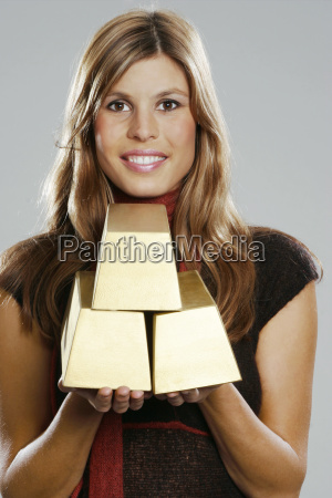 young woman holding three bars of