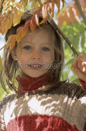 girl 4 5 holding branch portrait