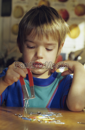 boy playing with a magnet