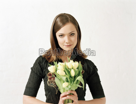 woman holding bunch of tulips portrait