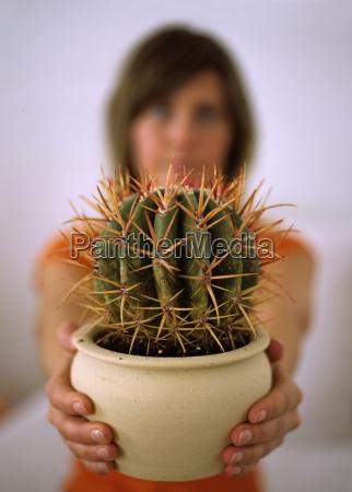 woman holding cactus close up
