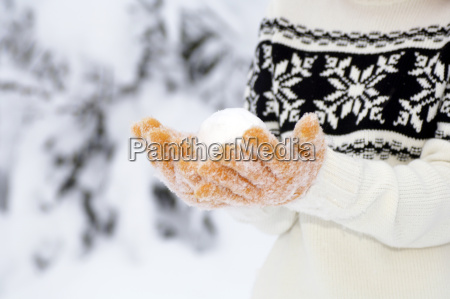 young woman with snowball close up