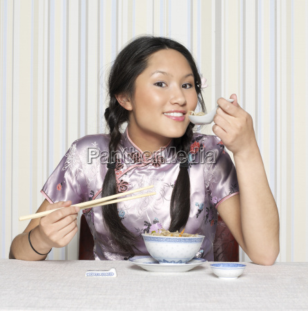 young woman eating smiling portrait